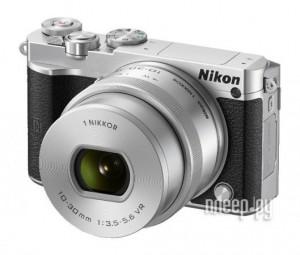 О вреде Wi-Fi<br><table border=0 cellpadding=1 cellspacing=1 style=width: 100%;> <tbody>  <tr>   <td style=text-align: center;>    <strong>Nikon 1 J5 Kit</strong>&nbsp;- это великолепная высококачественная и ультрапортативная цифровая системная беззеркальная фотокамера, которая, благодаря чрезвычайно компактным размерам, станет Вашим верным ежедневным спутником. Прекрасное качество картинки, а также отличные скорость фокусировки и съемки (превышающей даже скорость цифровых зеркальных фотокамер) позволяют создавать действительно захватывающие 20,8-мегапиксельные снимки, а также невероятно резкие 4К видеоролики! Оснащенная крупной КМОП-матрицей камера J5 позволит Вам достичь новых высот в столь сложном, но интересном ремесле - фотосъемке.</td>   <td style=text-align: center;>    </td>  </tr>  <tr>   <td style=text-align: center;>    </td>   <td style=text-align: center;>    Камера&nbsp;<strong>Nikon 1 J5 Kit</strong>&nbsp;удивительно удобна в управлении - помимо классических кнопок и дисков, устройство снабжено чрезвычайно удобным отклоняемым экраном с малым временем отклика, а наличие встроенных модулей Wi-Fi и NFC позволит с поражающей легкостью и скоростью делиться своими фотографиями, загрузив их с помощью смартфонов, планшетов или других смарт-устройств. Крепкий корпус вкупе с использованием самых выскококачественных материалов сделали камеру невероятно надежной и прочной, так что Вы сможете без беспокойств брать ее с собой даже каждый день.</td>  </tr> </tbody></table><br /><br /><br /><span style=font-size:22px;><strong>Обзор фотоаппарата Nikon 1 J5</strong></span><br /><br /><br />Фотографы, когда-либо мечтавшие о камере, которая бы вобрала в себя достоинства всех видов фототехники одновременно, наконец-то могут получить давно вожделенное. В лице системных беззеркальных камер, разумеется, пик популярности которых приходится как-раз на наши дни и сопровождается ростом числа всевозможных аксессуаров, изготовители которых не упускают возможности подзаработать на 